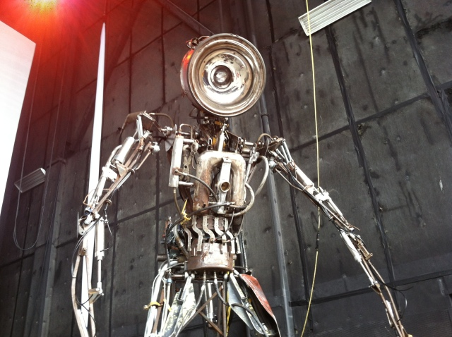 One of the towering spotlight robots. They flanked the stage and moved with lumbering, mechanical torque.